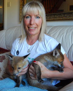 Kit Berry cuddles fox cubs