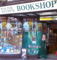 Kit Berry standing outside Walter Henry's Bookshop in Bideford, Devon