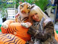 Kit Berry cuddles tiger