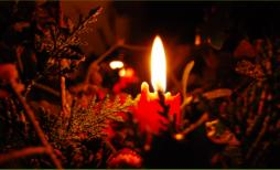 Red candle and evergreens